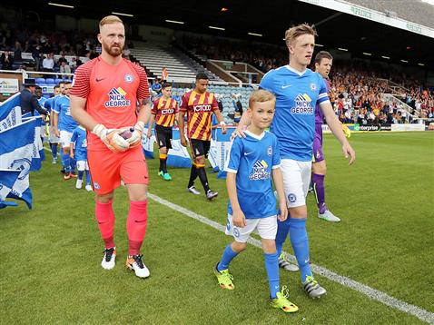 Chris Forrester leads out Ben Alnwick & Posh v Bradford