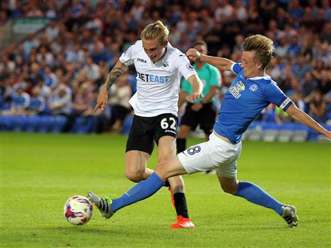 Chris Forrester tackles Swanseas Olli McBurnie