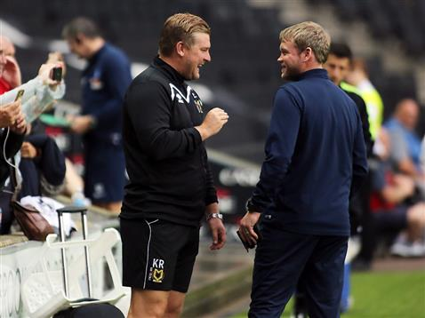 Grant McCann joks with MK Dons manager Karl Robinson