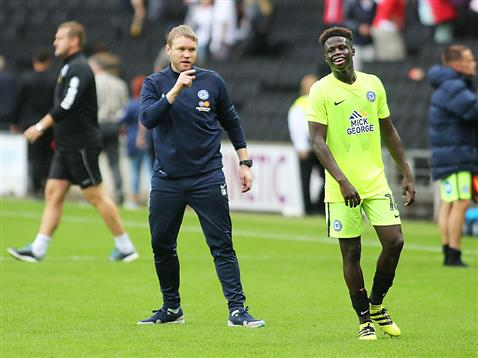 Grant McCann talks to a happy Leo Da Silva Lopes after the win over MK Dons