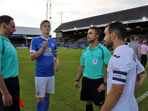 Referee James Adcock watches Chris Forrester toss the coin v Swansea