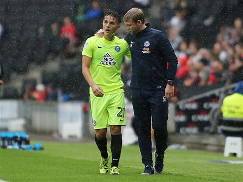 Tom Nichols gets advice from Grant McCann v MK Dons