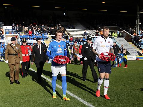 chris-forrester-brings-out-poppy-wreath-alonside-bolton-captain-2