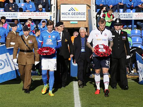 chris-forrester-brings-out-poppy-wreath-alonside-bolton-captain