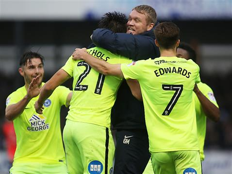 grant-mccann-celebrate-with-the-players-after-the-92nd-minute-winner-from-tom-nichols-v-bristol-rovers