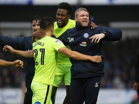 grant-mccann-celebrates-with-goalscorers-tom-nichols-and-shaq-coulthirst-v-bristol-rovers