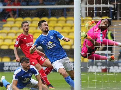 Gwion Edwards and Jack Baldwin watch the ball go in v Swindon