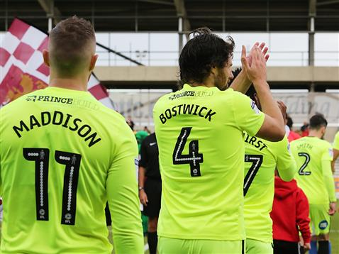 michael-bostwick-and-marcus-maddison-wearing-their-luminous-yeelow-posh-kit-v-northampton