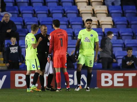 referee-darren-handley-talks-to-goalkeeper-luke-mcgee-after-sending-off-ryan-tafazolli-v-shrewsbury