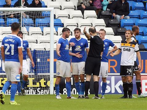 referee-graham-horwood-shows-andrew-hughes-the-direction-of-the-changing-rooms-v-port-vale