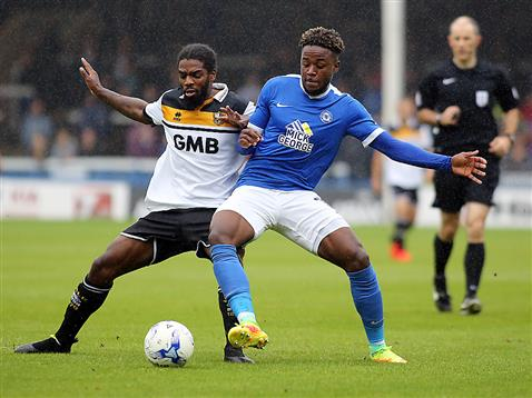 Jermaine Anderson v Port Vale's Anthony Grant