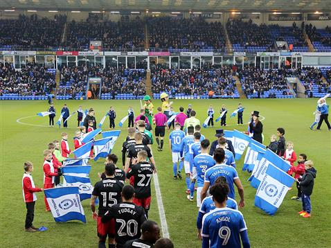 referee-john-brooks-leads-out-posh-and-coventry
