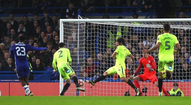 batshuayi-scores-the-second-chelsea-goal-v-posh-which-cant-be-blocked-by-michael-smith-or-michael-bostwick
