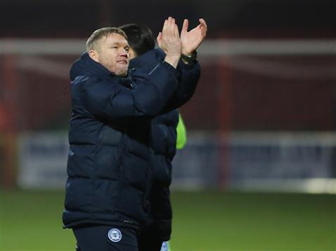 grant-mccann-applauds-the-posh-fans-after-the-win-at-swindon