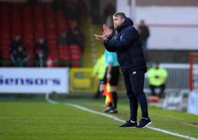 Posh manager Grant McCann urges his players on at Swindon. Photo: Joe Dent/theposh.com.