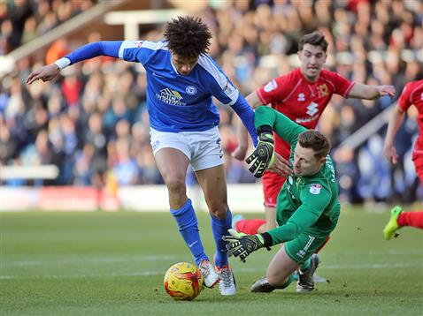 lee-angol-rounds-the-mk-dons-keeper-only-to-see-his-effort-cleared-off-the-line