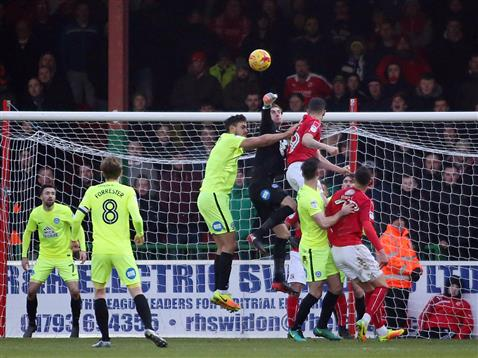 luke-mcgee-punches-away-a-corner-from-swindon