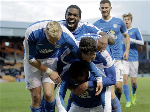 posh-players-celebrate-the-2nd-goal-by-junior-morias-v-port-vale