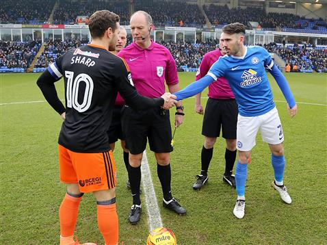 referee-andy-haines-watches-michael-smith-shake-hands-with-sheffield-united-captain