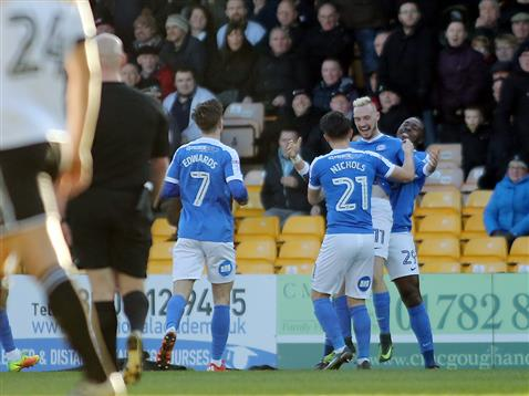 referee-charles-breakspear-watches-posh-players-celebrate-opening-goal-v-port-vale