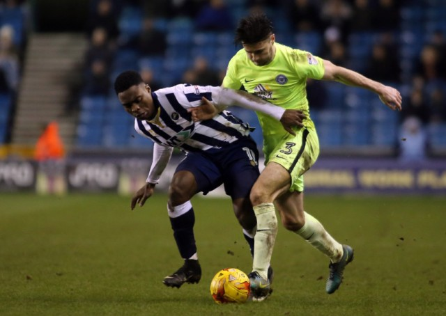 Posh left-back Andrew Hughes battles with Fred Onyedinma of Millwall. Photo: Joe Dent/theposh.com.