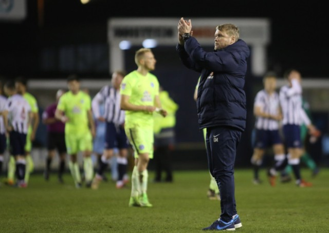 Posh boss Grant McCann acknowledges his club's fans at the end of the Millwall game. Photo: Joe Dent/theposh.com.