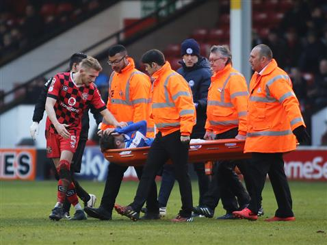 gwion-edwards-gets-carried-off-v-walsall