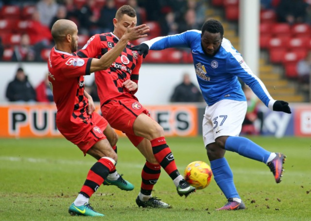 Junior Morias of Peterborough United is closed down by the Walsall defence. Picture: Joe Dent