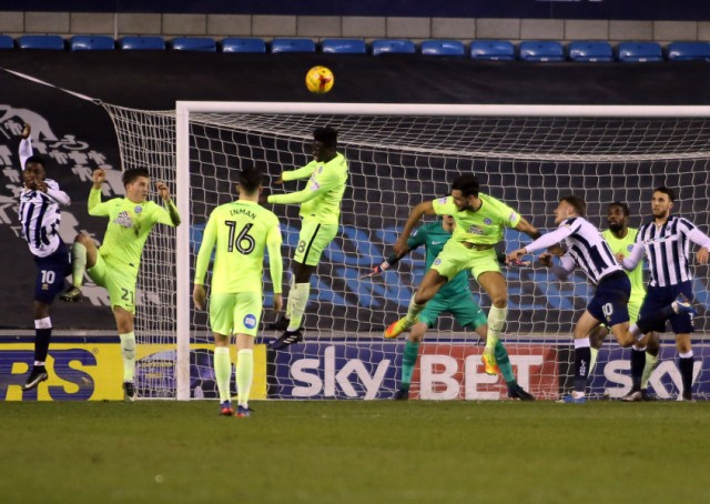 Posh midfielder Leo Da Silva Lopes leaps to clear a first-half Millwall corner. Photo: Joe Dent/theposh.com.