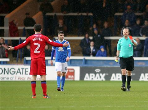 referee-chris-sarginson-shows-the-first-of-three-red-cards-posh-3-1-rochdale