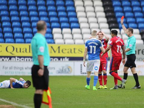 referee-chris-sarginson-shows-the-second-of-three-red-cards-posh-3-1-rochdale