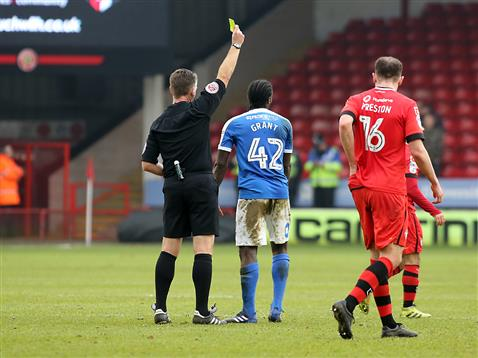 referee-mark-haywood-gives-a-very-harsh-yellow-card-to-anthony-grant-v-walsall