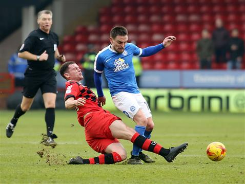 referee-mark-haywood-watches-a-walsall-player-tackle-paul-taylor